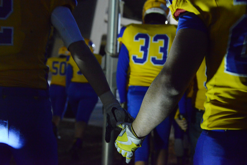 Justin Sheely | The Sheridan Press<br /> The Broncs head back to the field after halftime during the class 4A state championship match against Natrona County High School Saturday, November 11, 2017, at War Memorial Stadium in Laramie. The Broncs claimed their third-straight state title after beating the Mustangs 28-14. The Sheridan Broncs were undefeated for their season.