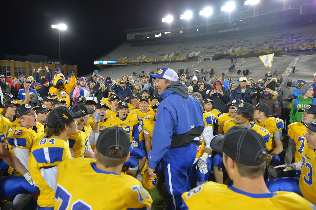 Justin Sheely | The Sheridan Press<br /> Head coach Don Julian speaks to his players in a huddle in the class 4A state championship match against Natrona County High School Saturday, November 11, 2017, at War Memorial Stadium in Laramie. The Broncs claimed their third-straight state title after beating the Mustangs 28-14. The Sheridan Broncs were undefeated for their season.