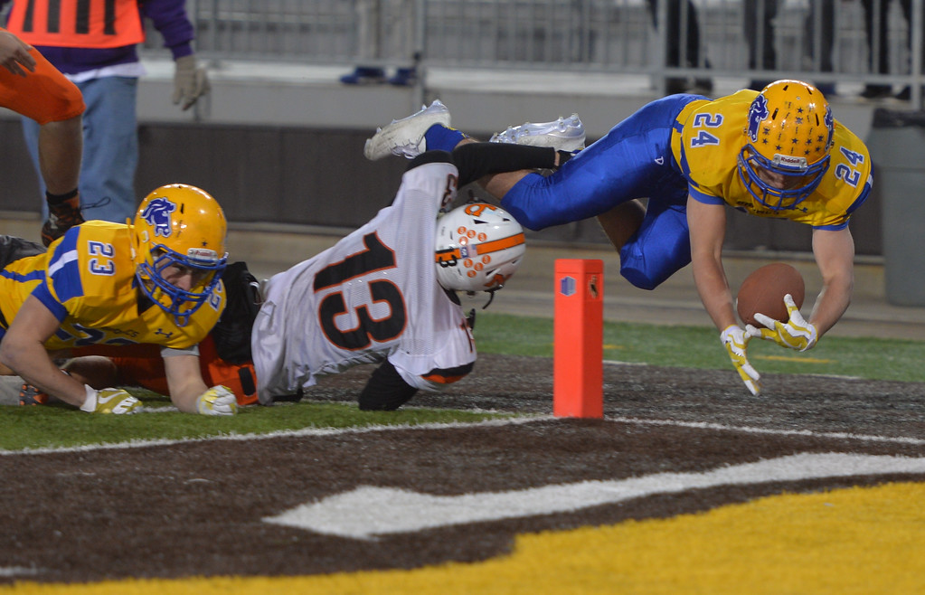 Justin Sheely | The Sheridan Press<br /> Sheridan's Kyle Custis is tackled one yard short in the second half of the class 4A state championship match against Natrona County High School Saturday, November 11, 2017, at War Memorial Stadium in Laramie. The Broncs claimed their third-straight state title after beating the Mustangs 28-14. The Sheridan Broncs were undefeated for their season.