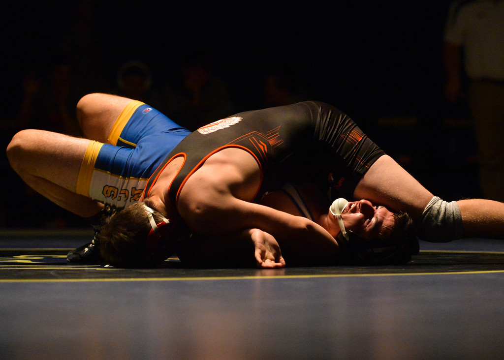 Justin Sheely | The Sheridan Press<br /> Sheridan's Camden McArthur is pinned by Worland's Isaac Goncalves at Sheridan High School Thursday, Dec. 6, 2017. The Broncs rallied for a win 43-27.