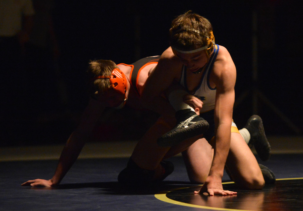 Justin Sheely | The Sheridan Press<br /> Sheridan's Hayden Crow, right, fights Worland's Hayden Johnston at Sheridan High School Thursday, Dec. 6, 2017. The Broncs rallied for a win 43-27.