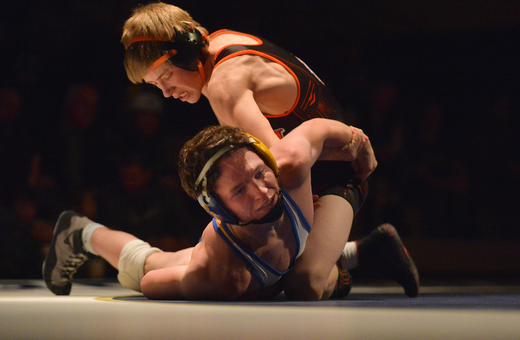 Justin Sheely | The Sheridan Press<br /> Sheridan's Trevon Covolo survives Worland's Daniel Weyrich at Sheridan High School Thursday, Dec. 6, 2017. The Broncs rallied for a win 43-27.