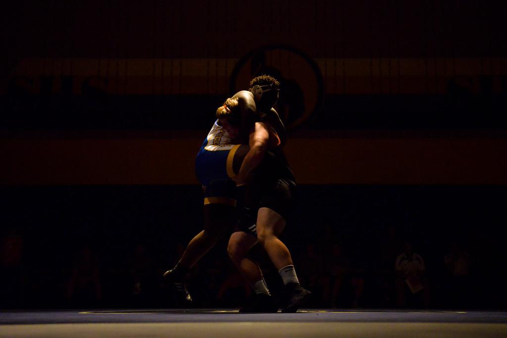 Justin Sheely | The Sheridan Press<br /> Sheridan's Wesley Ndago, left, battles Worland's Morgan Tigner at Sheridan High School Thursday, Dec. 6, 2017. The Broncs rallied for a win 43-27.