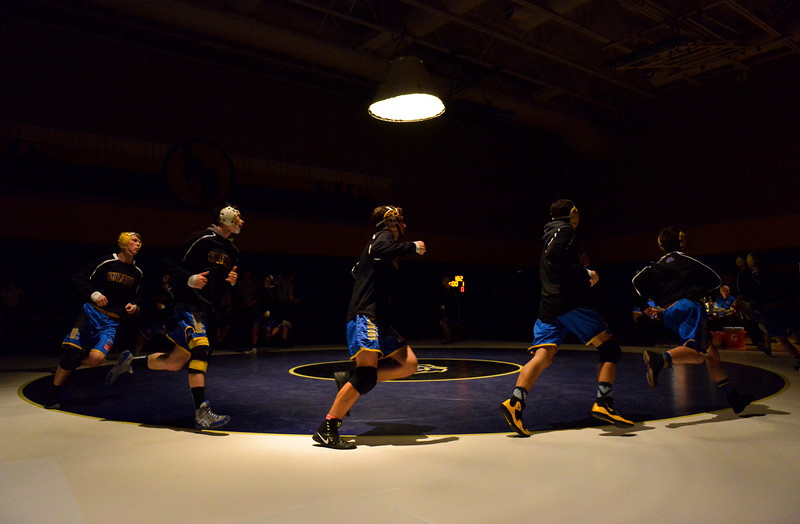 Justin Sheely | The Sheridan Press	<br /> The Broncs make their entry during the wrestling dual against the Worland Warriors at Sheridan High School Thursday, Dec. 6, 2017. The Broncs rallied for a win 43-27.