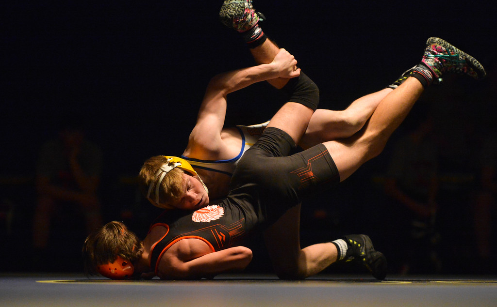 Justin Sheely | The Sheridan Press<br /> Sheridan's Reece Osborne dominates Worland's Domanic Hartley at Sheridan High School Thursday, Dec. 6, 2017. The Broncs rallied for a win 43-27.