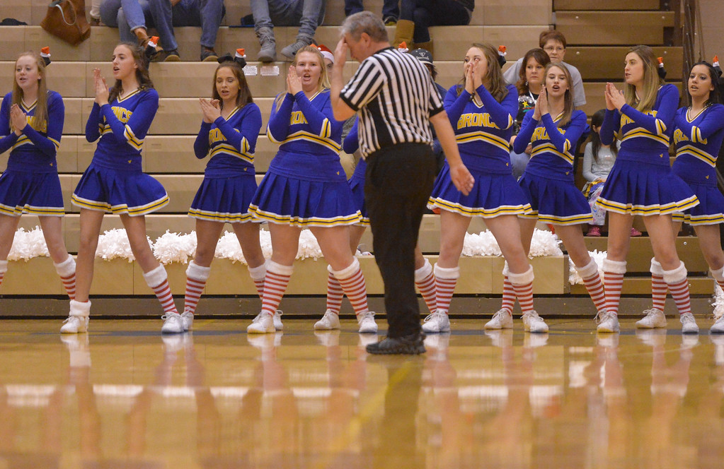 Justin Sheely | The Sheridan Press<br /> Sheridan's cheerleaders clap their hands during the game against the Mustangs at Sheridan High School Friday, Dec. 22, 2017. Broncs won 64-50.