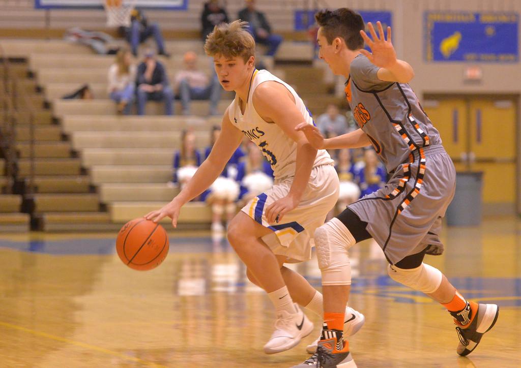 Justin Sheely | The Sheridan Press<br /> Sheridan's Tristan Bower is guarded by Mustang's Brennan Hagar at Sheridan High School Friday, Dec. 22, 2017. Broncs won 64-50.