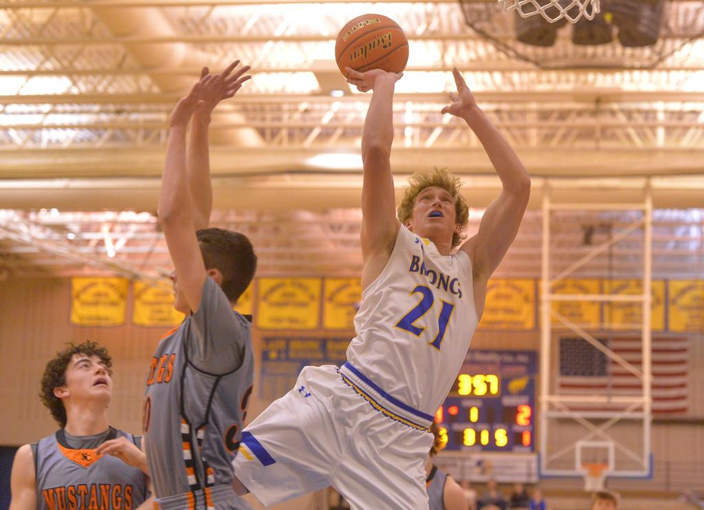 Justin Sheely | The Sheridan Press<br /> Sheridan's Parker Christensen scores over the Mustangs at Sheridan High School Friday, Dec. 22, 2017. Broncs won 64-50.