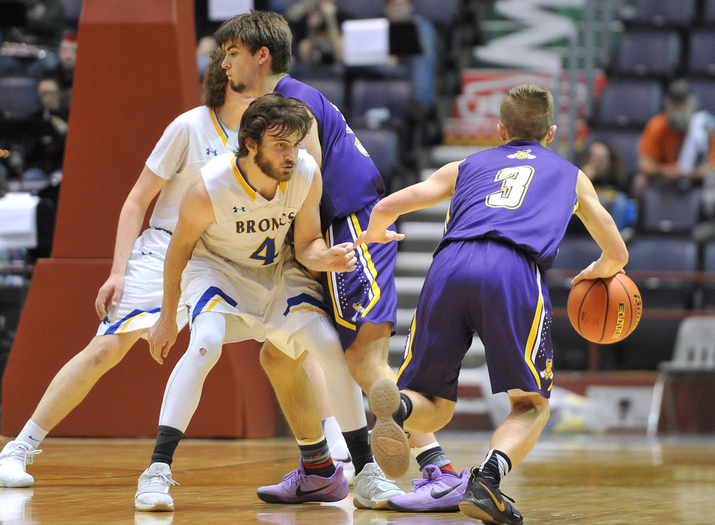 Justin Sheely | The Sheridan Press<br /> Sheridan's Aaron Woodward (4) runs into Campbell County's screen set by Shane Belt, center, as Camel's Trey Hladky (3) drives to the basket during the boys class 4A State Championship at the Casper Event Center Saturday, March 10, 2018. The Broncs fell to the Camels 71-61.