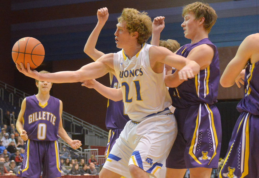 Justin Sheely | The Sheridan Press<br /> Sheridan's Parker Christensen, left, rebounds over Campbell County during the boys class 4A State Championship at the Casper Event Center Saturday, March 10, 2018. The Broncs fell to the Camels 71-61.