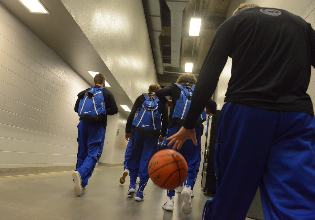 Justin Sheely | The Sheridan Press<br /> The Broncs walk to their locker room for a hudle prior to the boys class 4A State Championship at the Casper Event Center Saturday, March 10, 2018. The Broncs fell to the Camels 71-61.