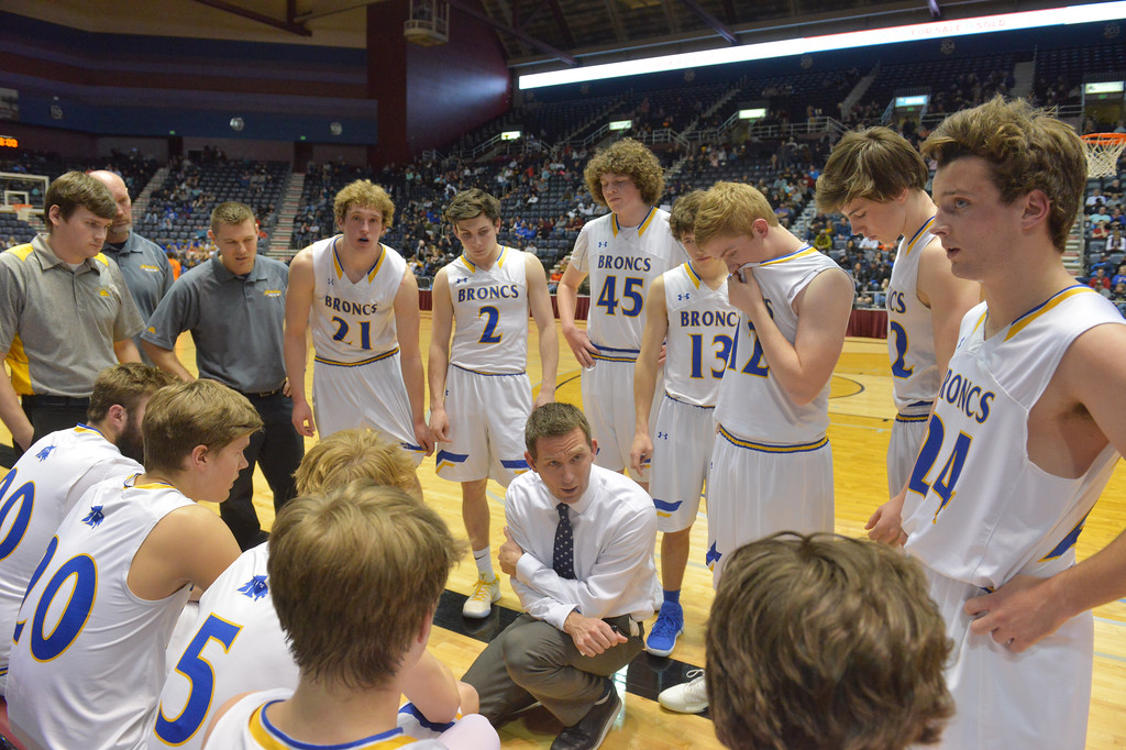 Justin Sheely | The Sheridan Press<br /> Broncs head coach Jeff Martini, center, calls a timeout in the second half of the boys class 4A State Championship at the Casper Event Center Saturday, March 10, 2018. The Broncs fell to the Camels 71-61.