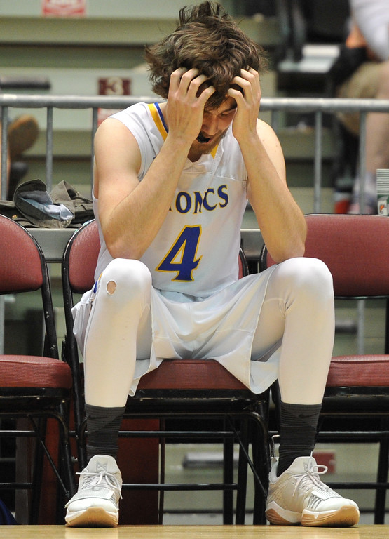 Justin Sheely | The Sheridan Press<br /> Sheridan's Aaron Woodward returns to the bench after a technical foul was called during the boys class 4A State Championship at the Casper Event Center Saturday, March 10, 2018. The Broncs fell to the Camels 71-61.