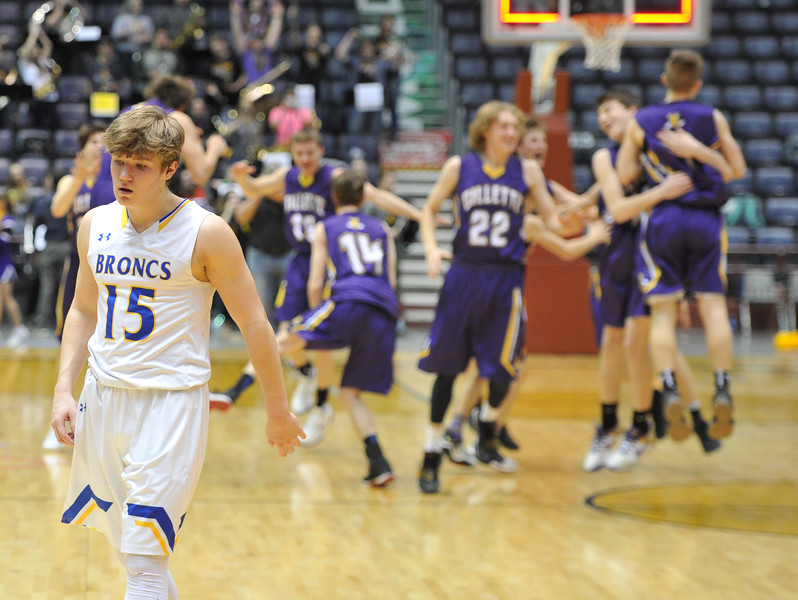 Justin Sheely | The Sheridan Press<br /> Sheridan's Tristan Bower walks away as Campbell County High School celebrates during the boys class 4A State Championship at the Casper Event Center Saturday, March 10, 2018. The Broncs fell to the Camels 71-61.