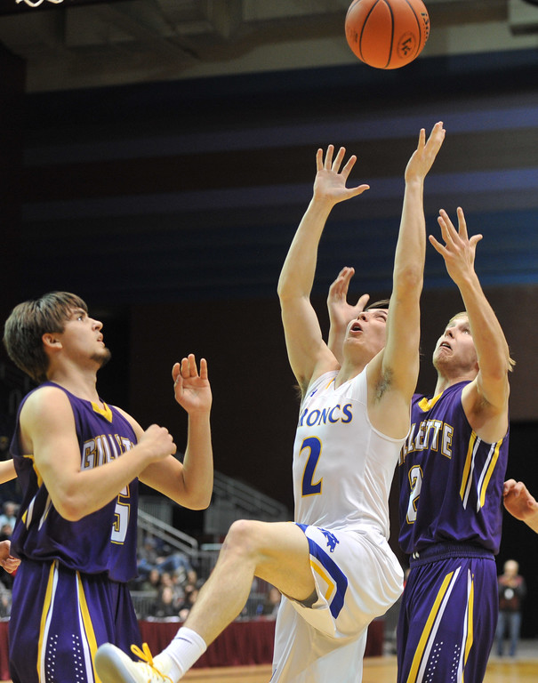 Justin Sheely | The Sheridan Press<br /> Sheridan's Aaron Sessions (2) goes for a rebound against Camel's Zach Bradley, center, as Shane Belt (5) looks on during the boys class 4A State Championship at the Casper Event Center Saturday, March 10, 2018. The Broncs fell to the Camels 71-61.