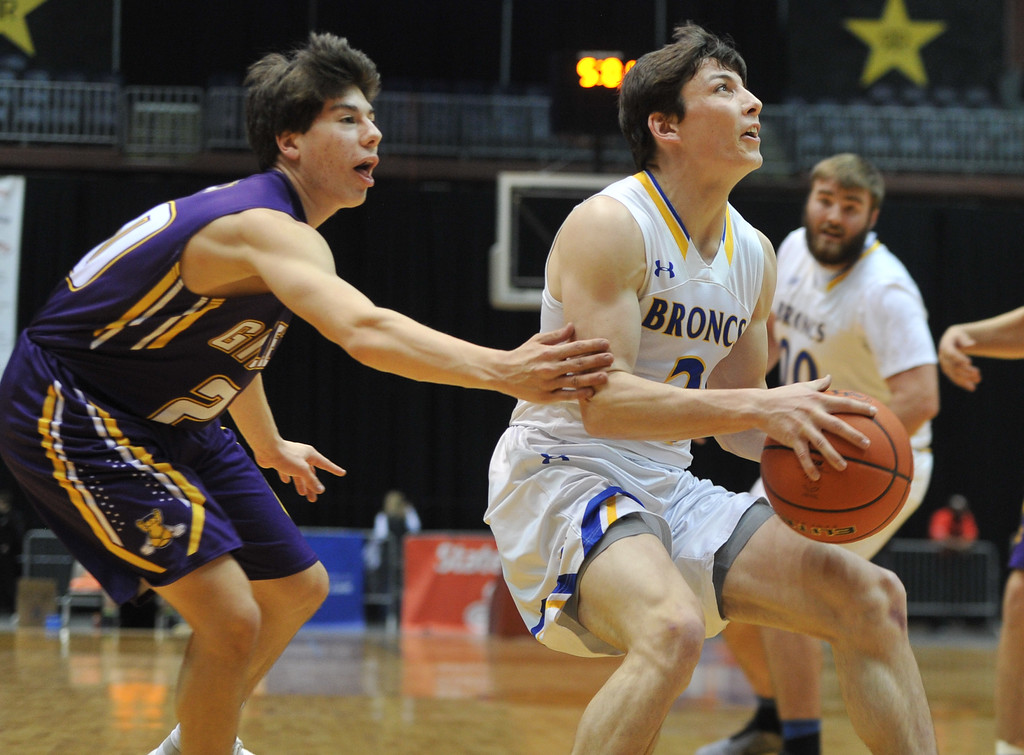 Justin Sheely | The Sheridan Press<br /> Sheridan's Aaron Sessions, right, moves past Campbell County's Tyler Neary during the boys class 4A State Championship at the Casper Event Center Saturday, March 10, 2018. The Broncs fell to the Camels 71-61.