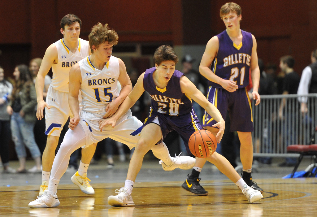 Justin Sheely | The Sheridan Press<br /> Sheridan's Aaron Sessions, left, and Tristan Bower guard Campbell County's Tyler Neary (20) and Dawson Miessler during the boys class 4A State Championship at the Casper Event Center Saturday, March 10, 2018. The Broncs fell to the Camels 71-61.