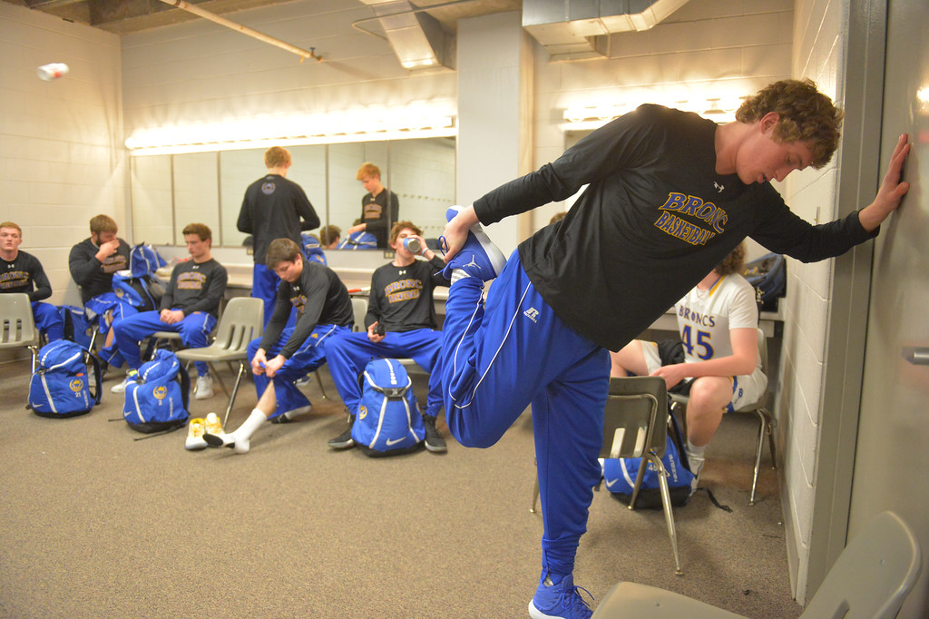 Justin Sheely | The Sheridan Press<br /> Sheridan's Parker Christensen, right, stretches in the Broncs' locker room during the boys class 4A State Championship at the Casper Event Center Saturday, March 10, 2018. The Broncs fell to the Camels 71-61.