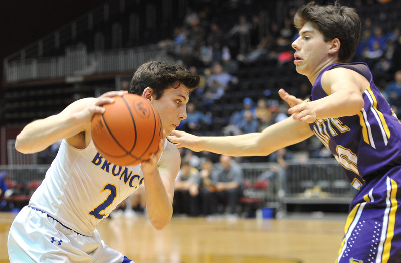 Justin Sheely   The Sheridan Press<br /> Sheridan's Aaron Sessions, left, moves the ball against Campbell County's Tyler Neary during the boys class 4A State Championship at the Casper Event Center Saturday, March 10, 2018. The Broncs fell to the Camels 71-61.