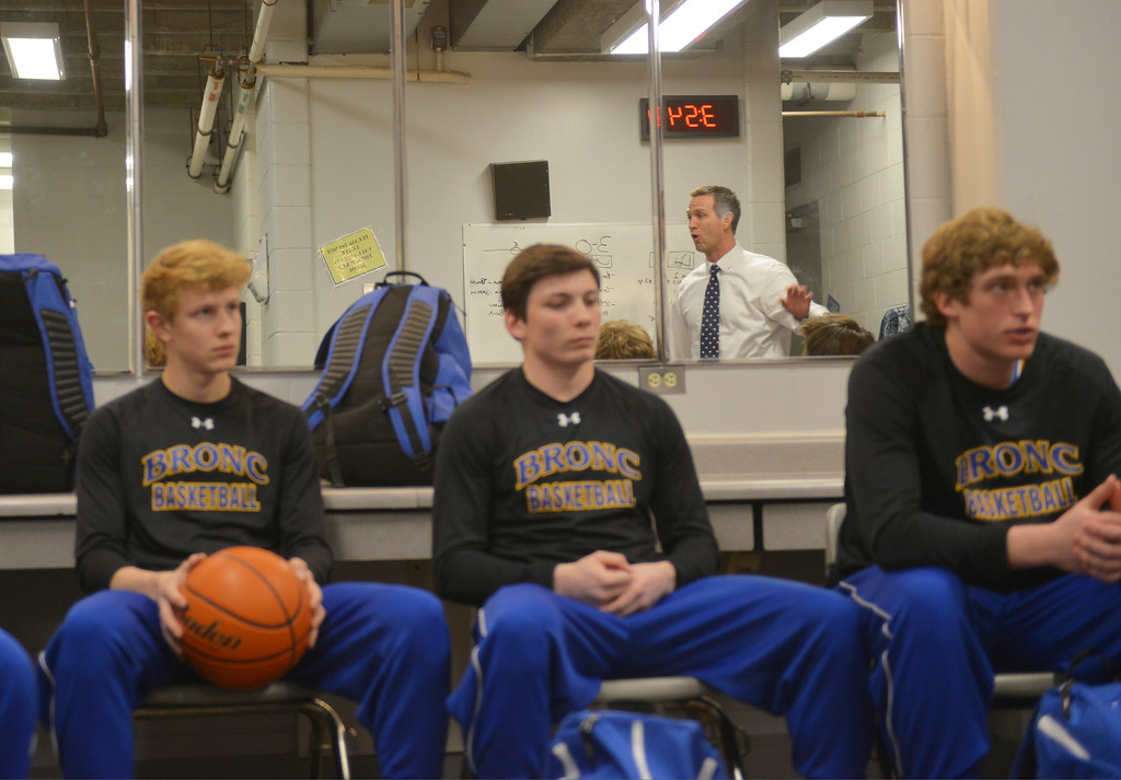 Justin Sheely | The Sheridan Press<br /> From left, Abraham Ross, Aaron Sessions and Parker Christensen listen as Broncs head coach Jeff Martini, back, talks to the the team during the boys class 4A State Championship at the Casper Event Center Saturday, March 10, 2018. The Broncs fell to the Camels 71-61.