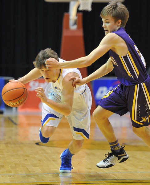 Justin Sheely | The Sheridan Press<br /> Sheridan's Noah Erickson drives the ball against Campbell County's Luke Hladky during the boys class 4A State Championship at the Casper Event Center Saturday, March 10, 2018. The Broncs fell to the Camels 71-61.