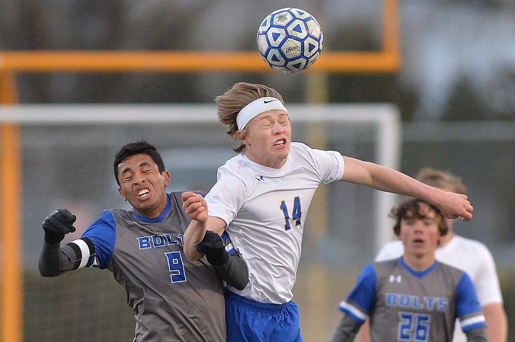 Justin Sheely | The Sheridan Press<br /> Sheridan's Chance Quarterman, right, and Thunder Basin's Cristian Martinez jump for a header at Homer Scott Field Friday, April 13, 2018. The Broncs lost 2-1.