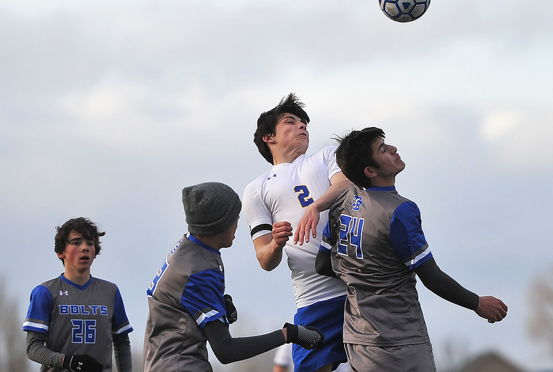 Justin Sheely | The Sheridan Press<br /> Sheridan's Aaron Sessions, center, gets the header over Thunder Basin's Dillon Cole at Homer Scott Field Friday, April 13, 2018. The Broncs lost 2-1.