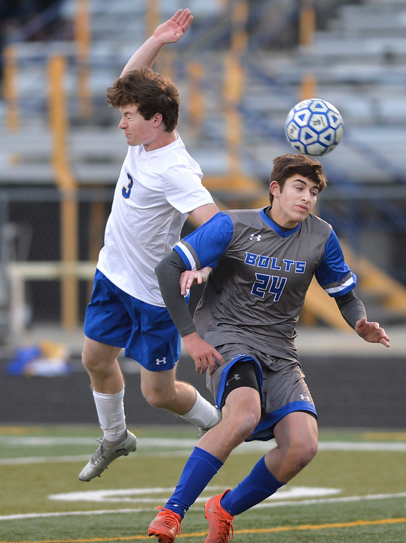 Justin Sheely | The Sheridan Press<br /> Sheridan's Toby Jacobs, left, and Thunder Basin's Dillon Cole fight for the ball at Homer Scott Field Friday, April 13, 2018. The Broncs lost 2-1.