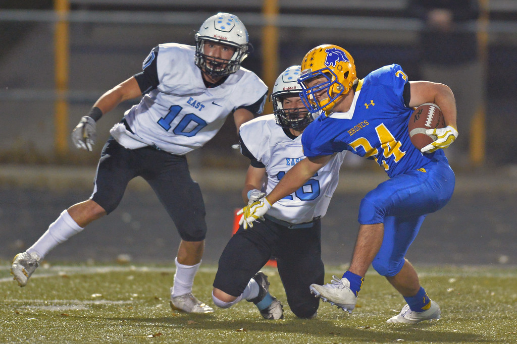 Kyle Custis (24) escapes two Cheyenne East defensive backs on his way to a 62-yard touchdown reception on Friday, Oct. 20 at Homer Scott Field. Custis finished the game with a rushing, receiving, defensive and kick-return touchdown. Mike Pruden | The Sheridan Press