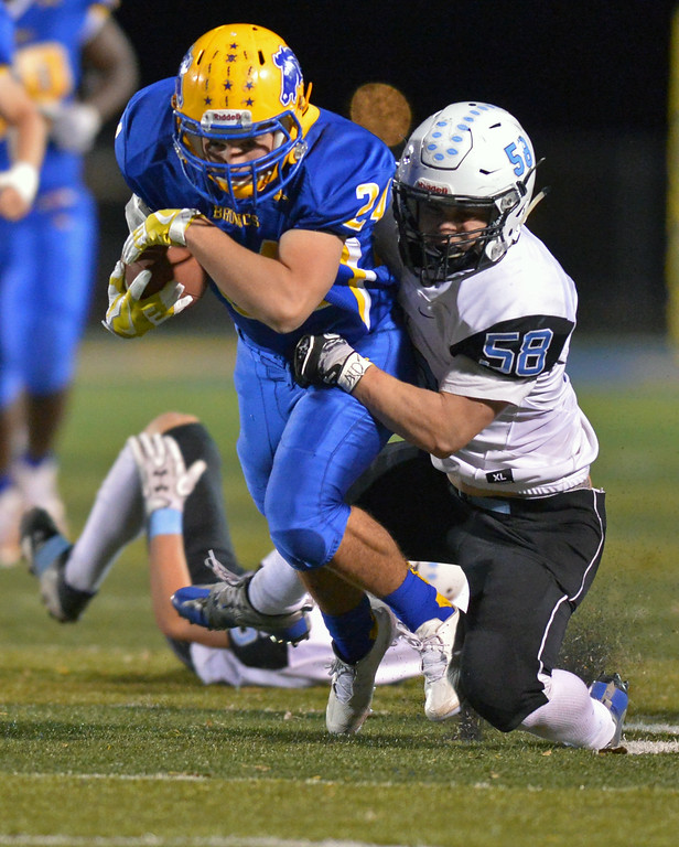 Kyle Custis is brought down by Zach Alexander during Sheridan's 38-14 win over Cheyenne East on Friday, Oct. 20 at Homer Scott FIeld. Mike Pruden | The Sheridan Press