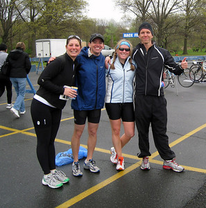 Brooke leaning in to join Dave, Ali, and Peter for a finish line photo!