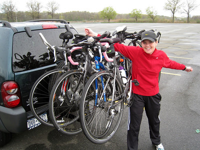 Aimee with her amazing bike rack.  Q: what's worth more, the bikes or the vehicle?  (sad answer: bikes :-)