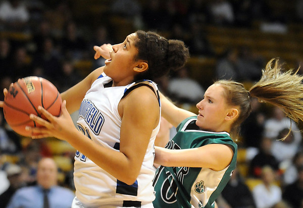 Broomfield's Tyana Medema goes to the basket against Conifer's Kat Noriega during the Final Four game at the Coors Event Center in Boulder on Wednesday <br /> <br /> March 10, 2010<br /> Staff photo/David R. Jennings