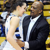 Broomfield's Katie Nehf  chats with Lonnie Porter, her father's coach from Regis University, after the Eagles defeated Conifer 59 to 32 during the Final Four game at the Coors Event Center in Boulder on Wednesday <br /> Nehf's father passed away earlier this year.<br /> March 10, 2010<br /> Staff photo/David R. Jennings
