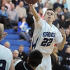 Cole Fiscus, Broomfield, passes the ball over Pueblo South during Friday's 1st round of the state 4A playoffs at Broomfield.<br /> February 25, 2011<br /> staff photo/David R. Jennings