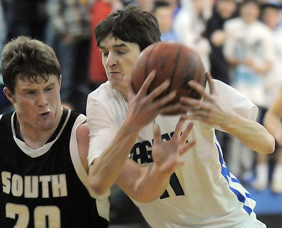 Broomfield's Ty Reeb fights for control of the ball with Corey Kemling, Pueblo South during Friday's 1st round of the state 4A playoffs at Broomfield.<br /> February 25, 2011<br /> staff photo/David R. Jennings