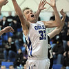 Dakota Smith, Broomfield, makes a rebound during play against Pueblo South during Friday's 1st round of the state 4A playoffs at Broomfield.<br /> February 25, 2011<br /> staff photo/David R. Jennings