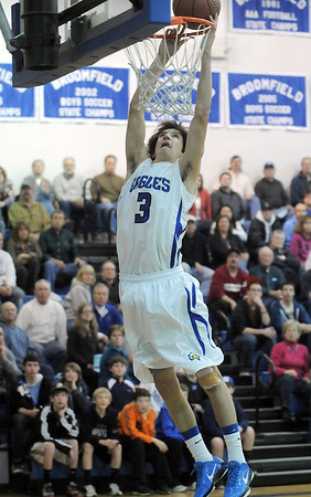 Nick Ongarato, Broomfield, puts the ball in the basket against Pueblo South during Friday's 1st round of the state 4A playoffs at Broomfield.<br /> February 25, 2011<br /> staff photo/David R. Jennings