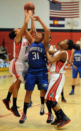 "Tyana Medema (31) of Broomfield, puts up a shot on Sydney Small, left, and  Tashwanette Carey of Denver East.<br /> For more photos,  go to  <a href=""http://www.dailycamera.com"">http://www.dailycamera.com</a>.<br /> Cliff Grassmick / December 11, 2010"