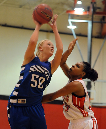 "Bre Burgesser (50) of Broomfield, tries to score on Tashwanette Carey of Denver East.<br /> For more photos,  go to  <a href=""http://www.dailycamera.com"">http://www.dailycamera.com</a>.<br /> Cliff Grassmick / December 11, 2010"