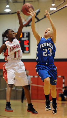 "Asia Roper, left, of Denver East, knocks the ball away from Morgan Rynearson of Broomfield.<br /> For more photos,  go to  <a href=""http://www.dailycamera.com"">http://www.dailycamera.com</a>.<br /> Cliff Grassmick / December 11, 2010"