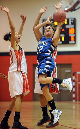 "Brittney Zec of Broomfield, puts up a shot on Halle Jones of Denver East.<br /> For more photos,  go to  <a href=""http://www.dailycamera.com"">http://www.dailycamera.com</a>.<br /> Cliff Grassmick / December 11, 2010"