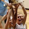 Autumn Chase, left, and Sarah Hix hold up the 4A Colorado State Championship trophy for Broomfield after the Eagles beat Longmont for the title.<br /> <br /> Cliff Grassmick / March 12, 2010