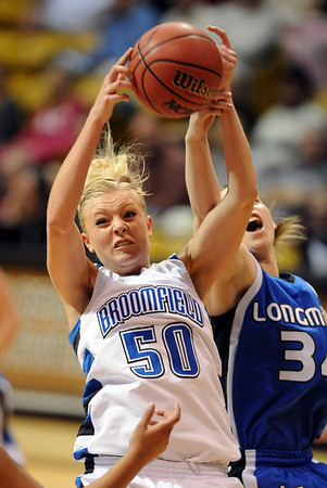 Bre Burgesser of Broomfield gets a rebound from Jill Van Thuyne of Longmont.<br /> <br /> Cliff Grassmick / March 12, 2010