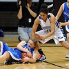 Tambre Haddock, left, of Longmont, goes to the floor to get the ball from Tyana Medema of Broomfield.<br /> Cliff Grassmick / March 12, 2010