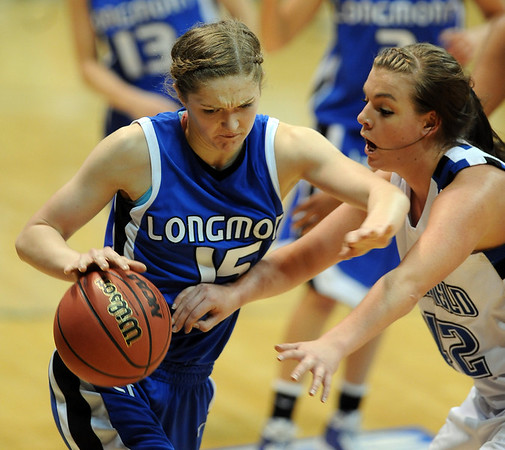 Tambre Haddock of Longmont tries to get around Renae Waters of broomfield.<br /> <br /> Cliff Grassmick / March 12, 2010