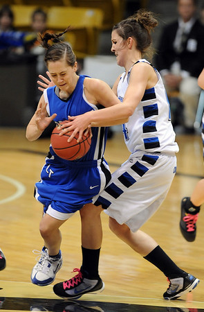 Erica Meier of Longmont is held up by Katie Nehf of Broomfield.<br /> <br /> Cliff Grassmick / March 12, 2010