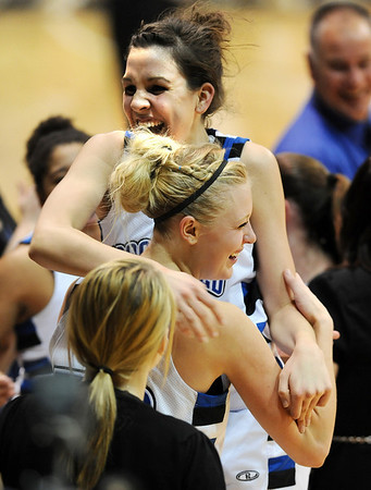 Katie Nehf jumps in the arms of Bre Burgesser after Broomfield wins the 4A State Championship on Friday.<br /> <br /> Cliff Grassmick / March 12, 2010