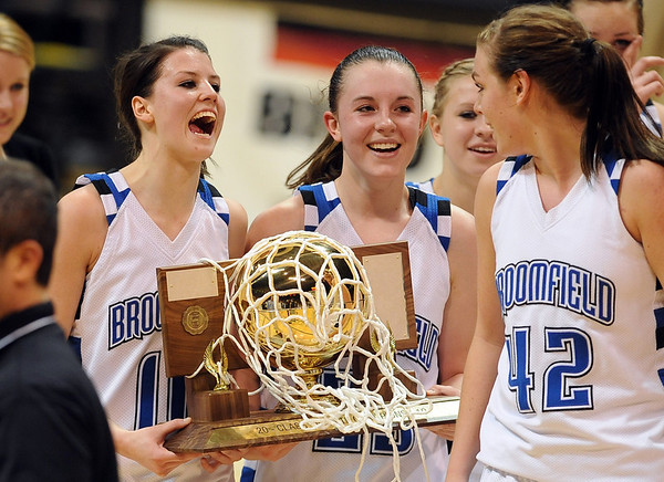 Autumn Chase, left, and Sarah Hix of Broomfield, walk off with the 4A State Championship trophy after beating Longmont.<br /> <br /> Cliff Grassmick / March 12, 2010