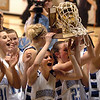 Autumn Chase, left, and Sarah Hix hold up the 4A Colorado State Championship trophy for Broomfield after the Eagles beat Longmont for the title.<br /> <br /> Cliff Grassmick / March 13, 2010
